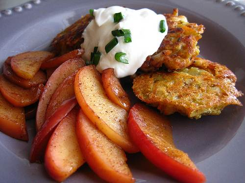Kosher Appetizer Potato Latkes Topped with Sour Cream for Chanukah Party