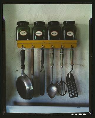 Angled Spatula Among Hanging Utensils