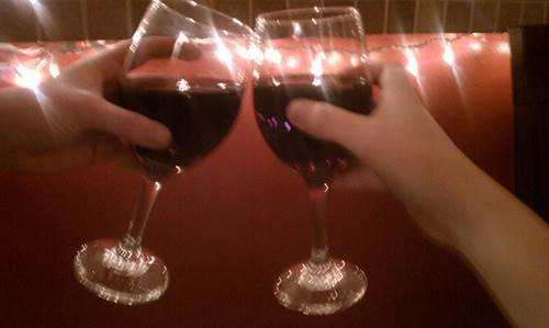 Cheers with Two Wine Glasses of Red Wine