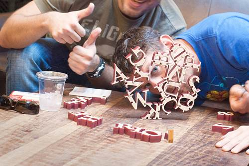 Friends Playing a Board Game in a Cafe
