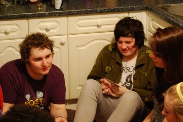 Friends Sitting on the Kitchen Floor